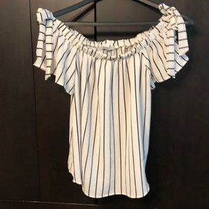 Off the shoulder cream and black blouse with ties